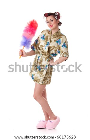 Young woman with whisk on a white background. Housekeeping.