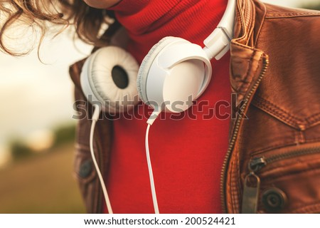 Young woman  with white headphones - stock photo