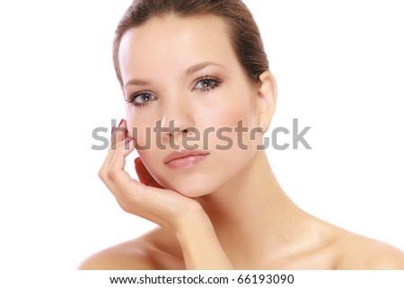 Young woman with white towel on her head - stock photo