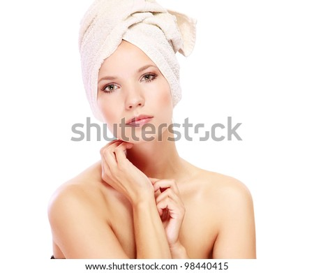 Young woman with white towel on her head , isolated on white background - stock photo