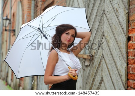 Young woman with white umbrella