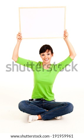 young woman with whiteboard, white background - stock photo