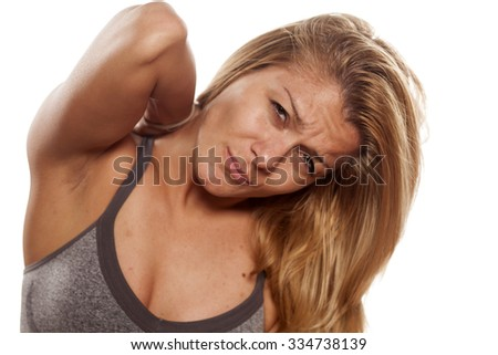 young woman without make-up and back pain - stock photo