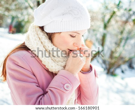 Young woman woman coughing winter park - stock photo