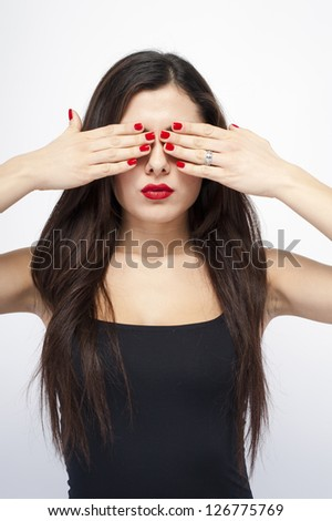 Young woman won't see on white background - stock photo