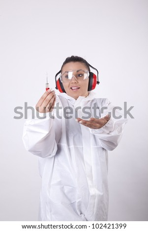 Young woman worker with a screwdriver having fun