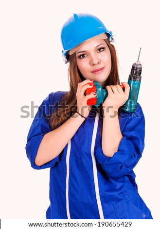 young woman worker with drill, white background