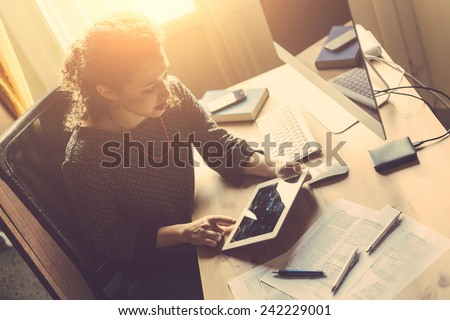 Young Woman Working at Home, Small Office - stock photo