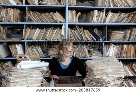 young woman working in an oldfashioned office - stock photo