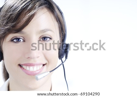 young woman working in call center with haedphones - stock photo