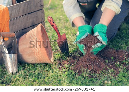 Young woman working in garden - stock photo