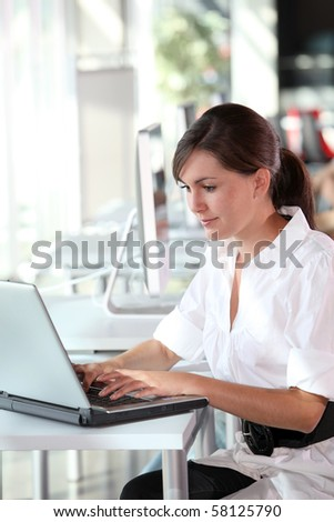 Young woman working in the office - stock photo
