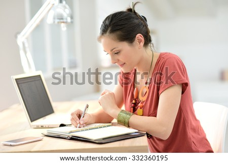 Young woman working on laptop, home-office