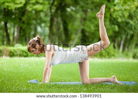 Young woman working out in the park