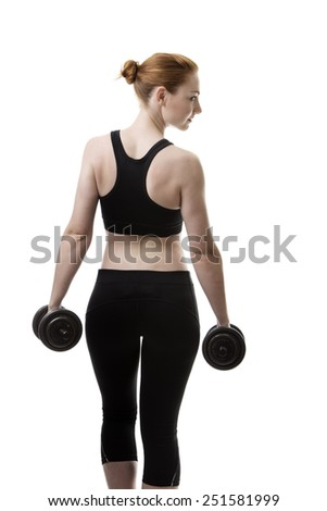 young woman working out lifting dumbbells