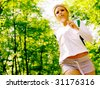 Young woman working out on a forest path. - stock photo