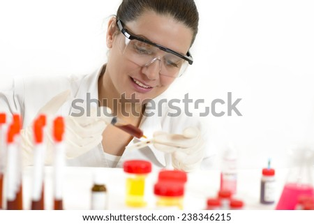 Young Woman working with biological material in a lab - stock photo