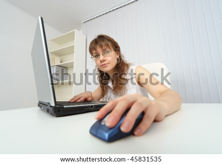 Young woman working with laptop photographed comic foreshortening