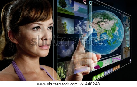 young woman works with futuristic display - stock photo