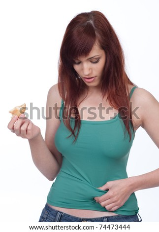 Young woman worried about her weight - stock photo