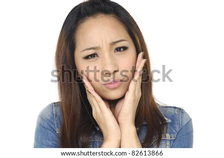 young woman worried isolated over white background. young - stock photo