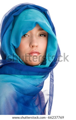 Young woman wrapped in blue scarf - stock photo