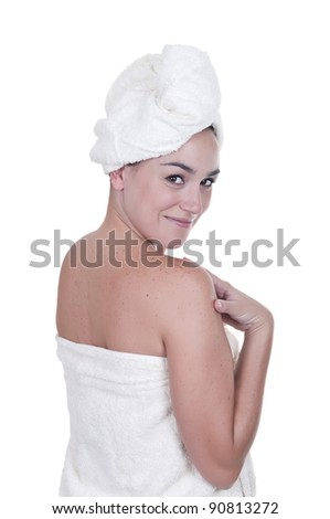 Young woman wrapped towel isolated on white background - stock photo