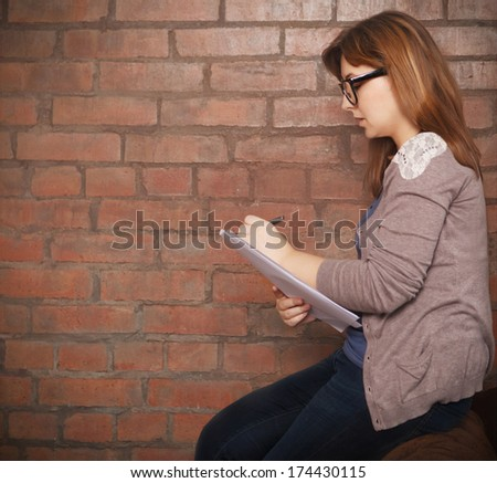 Young woman writer working in the loft - stock photo