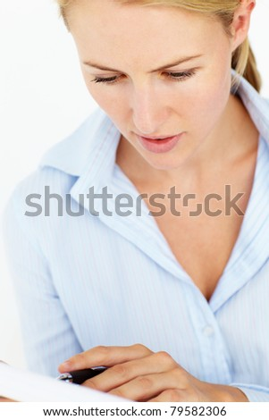 Young woman writing reading - stock photo