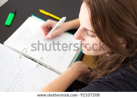 Young Woman Writing Something For The University