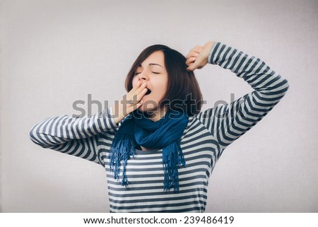 Young woman yawning - stock photo
