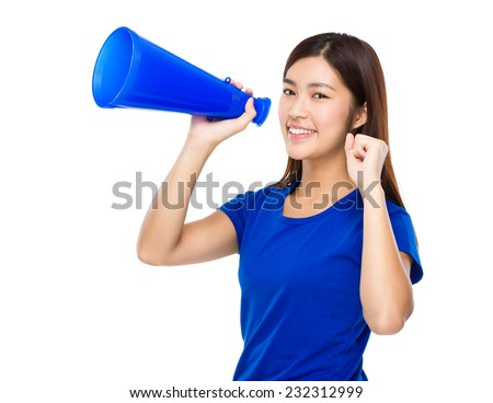 Young Woman yell with megaphone - stock photo