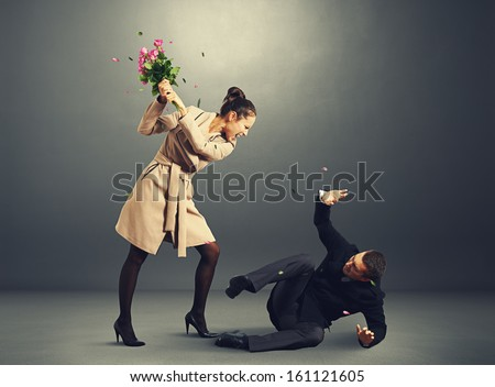 young woman yelling at frightened man - stock photo