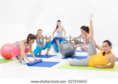 Young women after aerobics class in a studio.