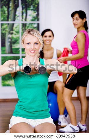 young women at aerobics training in the gym