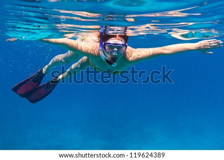 Young women at snorkeling in the Andaman sea - stock photo
