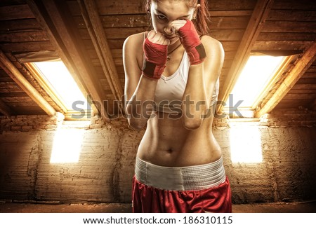 Young women boxing, exercise in the attic - stock photo