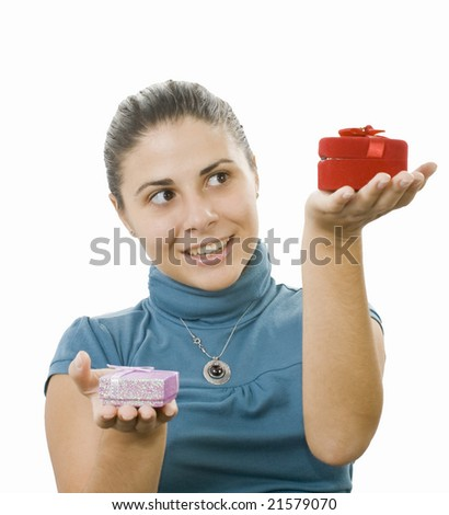 young women comparing two presents - stock photo
