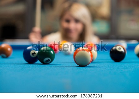 Young Women Concentrate On Ball