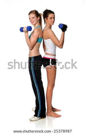 Young women curling dumbbell standing over white background - stock photo