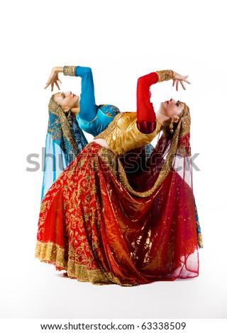 young women dance indian dance - stock photo