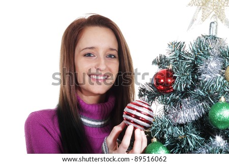 young women decorates a Christmas tree - stock photo