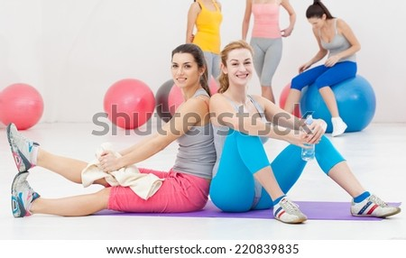 Young women doing aerobics in a studio.