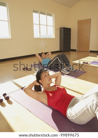 Young women doing crunches