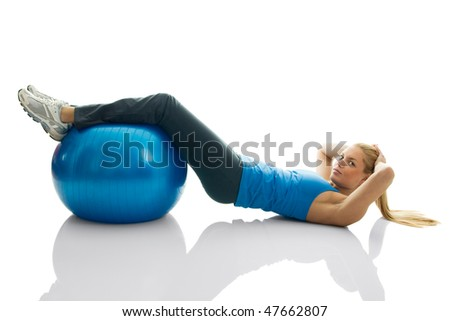 Young women doing crunches on fitness ball. Isolated on white