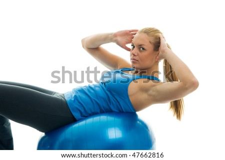 Young women doing crunches on fitness ball. Isolated on white - stock photo