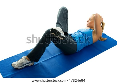 Young women doing crunches on fitness mat. Isolated on white - stock photo