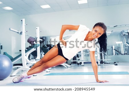 Young women doing exercises at the fitness club - stock photo