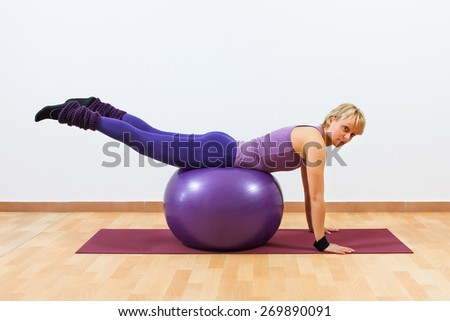 Young women  doing  pilates  exercises with fitness ball.Pilates - stock photo