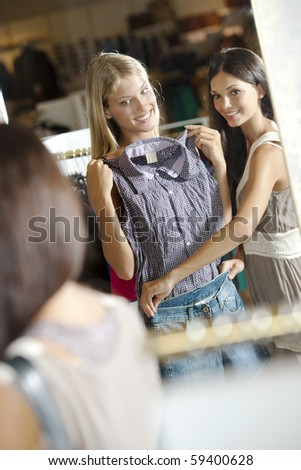 Young women doing shopping - stock photo